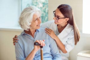 Home care worker helping senior woman in Flowery Branch, Georgia