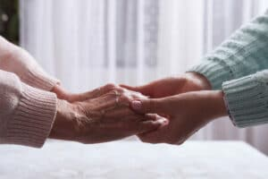 Elderly woman holding hands closeup in Flowery Branch, Georgia