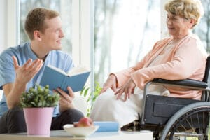 Senior Caregiver in Flowery Branch Providing Companionship for An Elderly Person