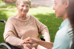 Senior Woman And Caring Nurse Talking Outside in Flowery Branch, Georgia